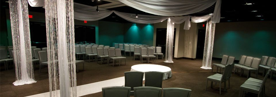 Wedding ceremony setup with hanging crystals and sashes at MEET Las Vegas