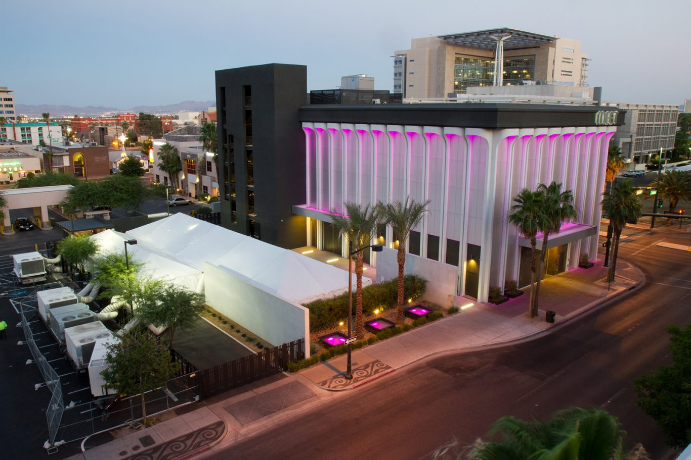 Image of facade of MEET Las Vegas with pink custom event lighting